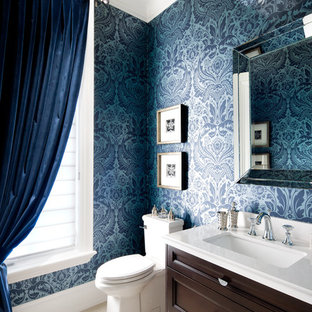 Inspiration for a timeless powder room remodel in Toronto with an undermount sink, recessed-panel cabinets, dark wood cabinets, a two-piece toilet and white countertops