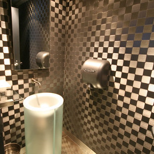 Industrial powder room in Dallas with a pedestal sink and gray tile.