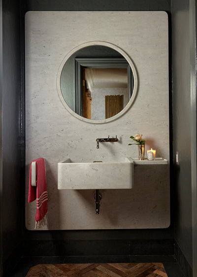 Mediterranean Powder Room by Beacon Construction Group Inc