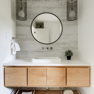 Example of a trendy powder room design in Austin