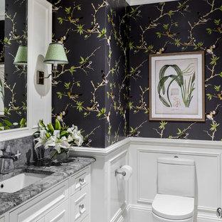 Idée de décoration pour un WC et toilettes tradition avec un placard avec porte à panneau encastré, des portes de placard blanches, un WC séparé, un mur noir, un sol en carrelage de terre cuite, un lavabo encastré, un sol multicolore et un plan de toilette gris.