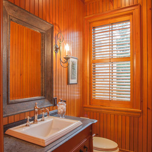 Small classic cloakroom in Toronto with a submerged sink, freestanding cabinets, red cabinets, granite worktops, a one-piece toilet, stone tiles and slate flooring.