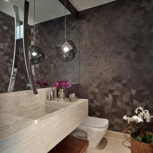 Immagine di un piccolo bagno di servizio contemporaneo con lavabo integrato e pavimento beige