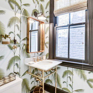 Inspiration for a tropical mosaic tile floor and white floor powder room remodel in DC Metro with a one-piece toilet, multicolored walls and a console sink