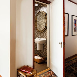 Powder room - small traditional brown tile and ceramic tile ceramic floor powder room idea in Portland with a wall-mount sink, a two-piece toilet and multicolored walls