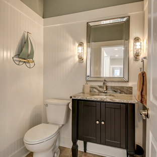 На фото: туалеты среднего размера в морском стиле с фасадами островного типа, темными деревянными фасадами, раздельным унитазом, зелеными стенами, полом из керамогранита, врезной раковиной, столешницей из гранита, разноцветным полом и разноцветной столешницей
