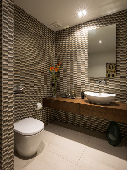 This is an example of a large contemporary cloakroom in auckland with flat panel cabinets