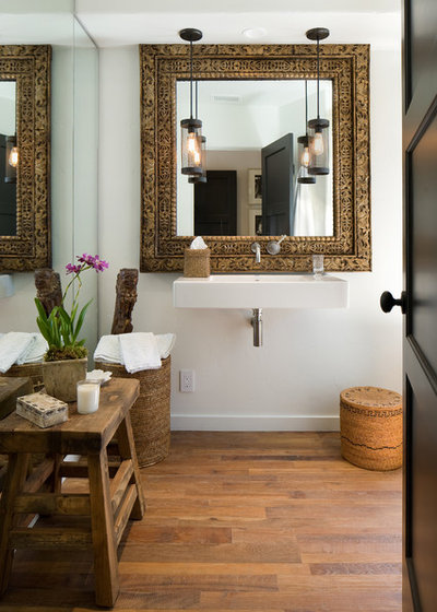 Mediterranean Powder Room by DD Ford Construction