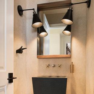 オーランドの小さいコンテンポラリースタイルのおしゃれなトイレ・洗面所 (分離型トイレ、ベージュのタイル、石タイル、ベージュの壁、ペデスタルシンク、亜鉛の洗面台) の写真