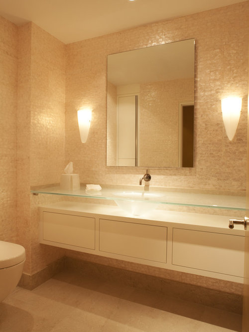 Contemporary Beige Tile Powder Room Idea In Minneapolis With Glass  Countertops And An Integrated Sink Part 33