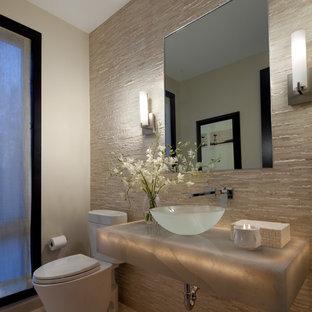 Inspiration pour un WC et toilettes design avec une vasque et un plan de toilette gris.