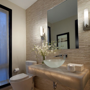 Example of a trendy powder room design in Detroit with a vessel sink and gray countertops