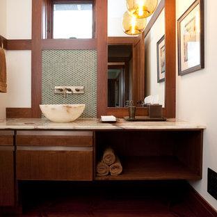 Выдающиеся фото от архитекторов и дизайнеров интерьера: маленький туалет в стиле современная классика с настольной раковиной, плоскими фасадами, столешницей из оникса, зеленой плиткой, плиткой мозаикой, белыми стенами, темным паркетным полом и темными деревянными фасадами