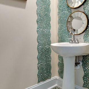 На фото: туалеты в стиле современная классика с бежевыми стенами, полом из галечной плитки, раковиной с пьедесталом и разноцветным полом