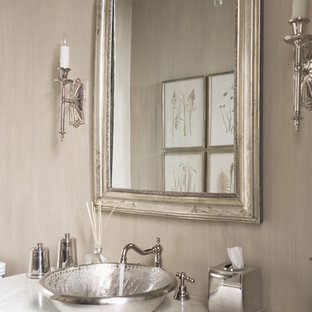 Example of a large transitional powder room design in Other with a vessel sink, marble countertops, beige walls and white countertops