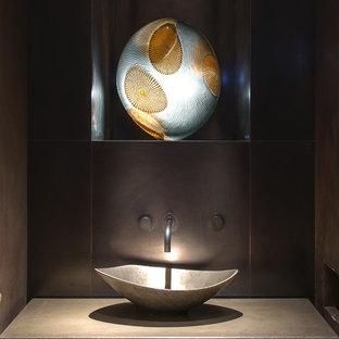 Esempio di un piccolo bagno di servizio design con lavabo a bacinella e top in cemento