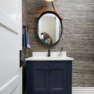 На фото: туалет в морском стиле с синими фасадами, разноцветными стенами, врезной раковиной и фасадами с утопленной филенкой с