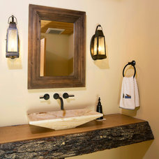 Rustic Powder Room by KohlMark Architects and Builders