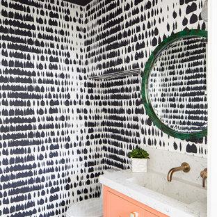 Exemple d'un WC et toilettes bord de mer de taille moyenne avec un placard à porte shaker, des portes de placard oranges, un plan de toilette en quartz modifié et un plan de toilette blanc.