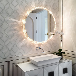 This is an example of a medium sized contemporary cloakroom in Miami with freestanding cabinets, multi-coloured walls, a vessel sink, white cabinets, marble flooring and grey floors.