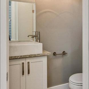 На фото: маленький туалет в стиле современная классика с фасадами в стиле шейкер, белыми фасадами, коричневыми стенами, паркетным полом среднего тона, настольной раковиной, столешницей из гранита, раздельным унитазом, коричневым полом и серой столешницей с