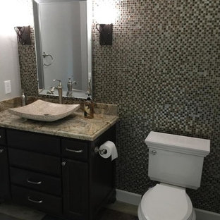 Inspiration for a medium sized classic cloakroom in Houston with recessed-panel cabinets, dark wood cabinets, a two-piece toilet, mosaic tiles, grey walls, a vessel sink, granite worktops and multi-coloured worktops.