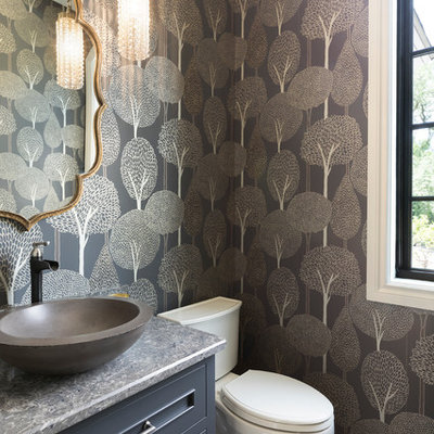Inspiration for a large mediterranean ceramic tile and multicolored floor powder room remodel in Minneapolis with blue cabinets, a two-piece toilet, a vessel sink, quartz countertops, gray countertops, recessed-panel cabinets and multicolored walls