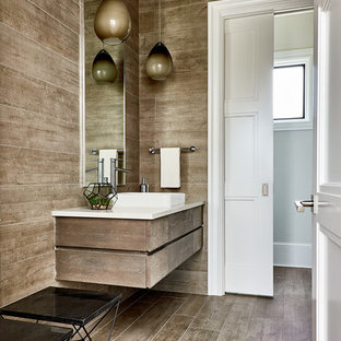 Mid-sized trendy brown tile and ceramic tile brown floor and ceramic floor powder room photo in Charlotte with brown walls, a vessel sink, quartzite countertops, flat-panel cabinets, dark wood cabinets and white countertops