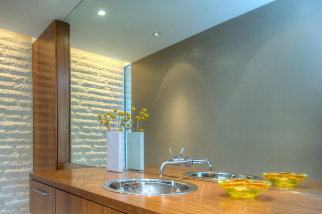 Modern Powder Room by Bertram Architects