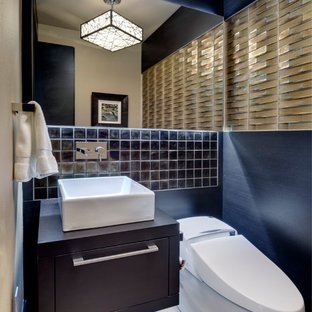 Trendy powder room photo in Dallas with a vessel sink and brown countertops