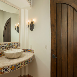 Medium sized mediterranean cloakroom in Phoenix with a vessel sink, multi-coloured tiles, white walls, terracotta flooring, tiled worktops and cement tiles.
