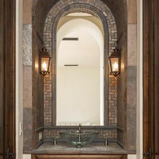 Свежая идея для дизайна: туалет среднего размера в средиземноморском стиле с фасадами с выступающей филенкой, темными деревянными фасадами, разноцветной плиткой, плиткой мозаикой, белыми стенами, столешницей из плитки и настольной раковиной - отличное фото интерьера