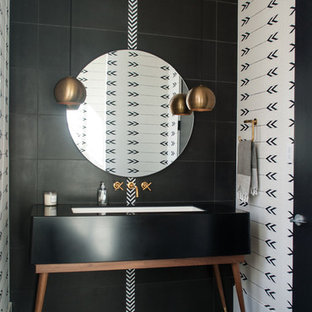 Photo of a contemporary cloakroom in Denver with freestanding cabinets, black tiles, black walls, black floors, a submerged sink and black worktops.