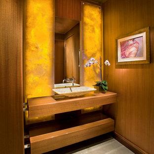 Idée de décoration pour un WC et toilettes asiatique avec une vasque.