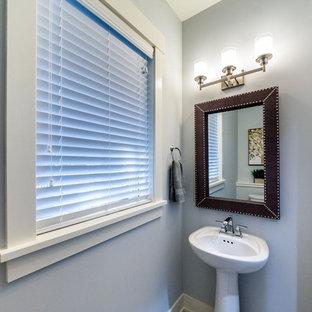 Esempio di un piccolo bagno di servizio chic con pareti grigie, pavimento in gres porcellanato, lavabo a colonna, top in acciaio inossidabile e pavimento beige