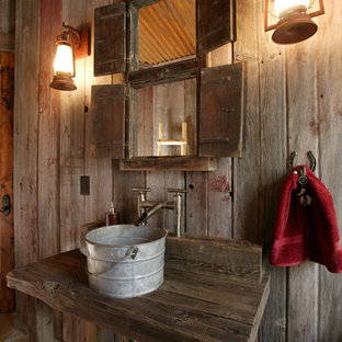 Powder room - rustic powder room idea in Denver with a vessel sink, wood countertops and brown countertops