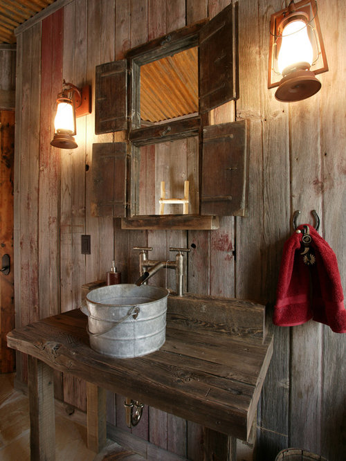 Rustic powder room idea in Denver with a vessel sink and wood countertops