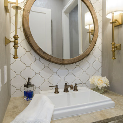 Inspiration for a transitional white tile and ceramic tile powder room remodel in Wichita with gray walls, a drop-in sink and beige countertops