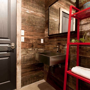 Powder room - industrial powder room idea in Montreal with a wall-mount sink