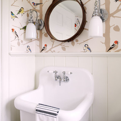Transitional wall paneling, wainscoting and wallpaper powder room photo in Philadelphia with multicolored walls and a wall-mount sink