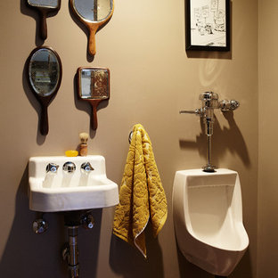 Powder room - eclectic powder room idea in Los Angeles with a wall-mount sink and an urinal