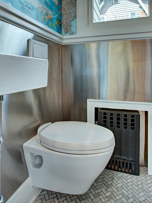 small eclectic marble floor powder room idea in new york with a wallmount sink