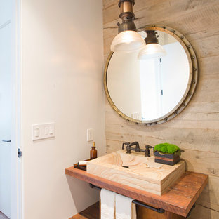 Powder room - small industrial medium tone wood floor powder room idea in Santa Barbara with a vessel sink, open cabinets, medium tone wood cabinets and wood countertops