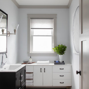 This is an example of a small classic cloakroom in Boston with freestanding cabinets, dark wood cabinets, grey walls, ceramic flooring, a submerged sink, engineered stone worktops, white floors and turquoise worktops.