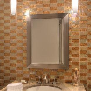 Неиссякаемый источник вдохновения для домашнего уюта: туалет среднего размера в современном стиле с фасадами островного типа, искусственно-состаренными фасадами, мраморной столешницей, стеклянной плиткой, коричневой плиткой, оранжевой плиткой, оранжевыми стенами и врезной раковиной