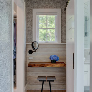 Inspiration for a coastal powder room remodel in New York