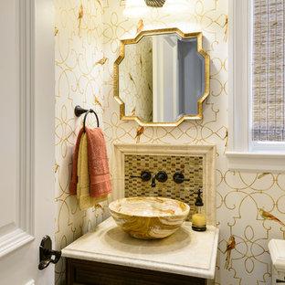Идея дизайна: маленький туалет в средиземноморском стиле с фасадами с выступающей филенкой, темными деревянными фасадами, раздельным унитазом, бежевой плиткой, мраморной плиткой, бежевыми стенами, светлым паркетным полом, настольной раковиной, мраморной столешницей, бежевым полом и бежевой столешницей
