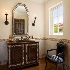 Mediterranean Powder Room by Giffin & Crane General Contractors, Inc.