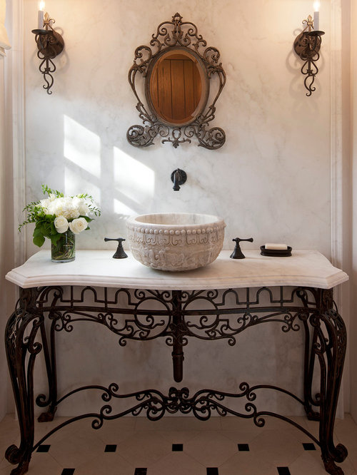 Example Of A Tuscan Marble Tile Powder Room Design In Santa Barbara With A  Vessel Sink