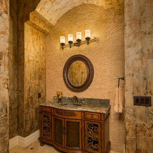 オースティンの中くらいの地中海スタイルのおしゃれなトイレ・洗面所 (家具調キャビネット、中間色木目調キャビネット、ベージュのタイル、石タイル、ベージュの壁、トラバーチンの床、アンダーカウンター洗面器、御影石の洗面台) の写真